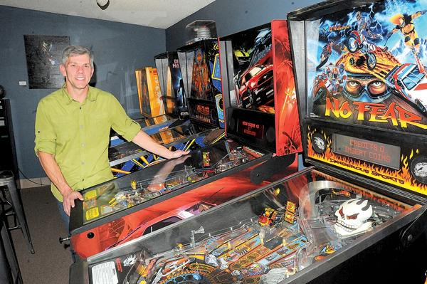 "Steve Long, who opened Tilt! Pinball arcade in Louisville last month, says: ""For years, I've collected pinball machines from all eras. Pinball was really my reason for starting this."" (Doug Pike / Colorado Hometown Weekly)"
